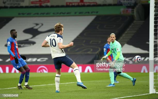 Harry Kane of Tottenham Hotspur scores their side's fourth goal past Vicente Guaita of Crystal Palace during the Premier League match between...