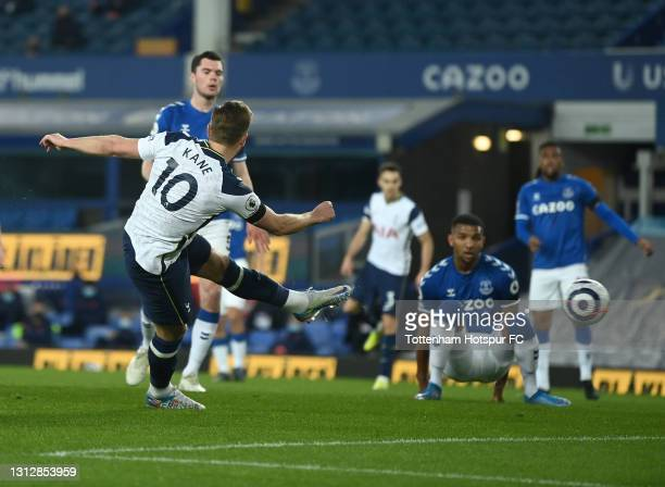 Harry Kane of Tottenham Hotspur scores their team's first goal during the Premier League match between Everton and Tottenham Hotspur at Goodison Park...