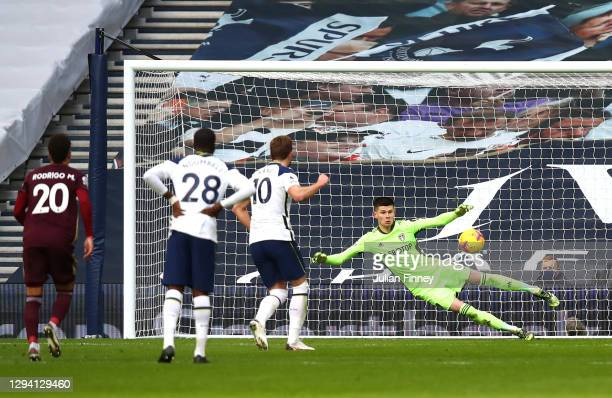 Harry Kane of Tottenham Hotspur scores their team's first goal from the penalty spot past Illan Meslier of Leeds United during the Premier League...