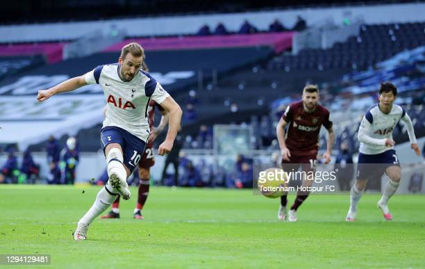 Harry Kane of Tottenham Hotspur scores their team's first goal from the penalty spot during the Premier League match between Tottenham Hotspur and...