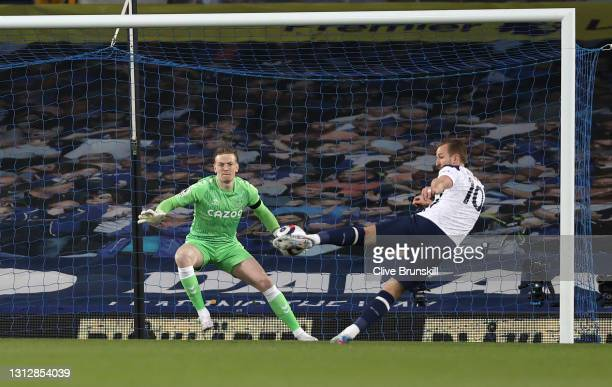 Harry Kane of Tottenham Hotspur scores their team's first goal past Jordan Pickford of Everton during the Premier League match between Everton and...