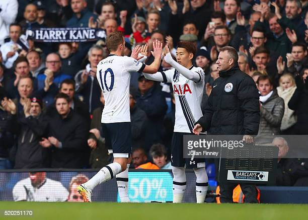 Harry Kane of Tottenham Hotspur shakes hands with substitute Son Heungmin during the Barclays Premier League match between Tottenham Hotspur and...