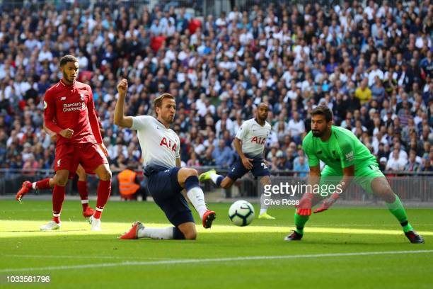 Harry Kane of Tottenham Hotspur shoots and misses during the Premier League match between Tottenham Hotspur and Liverpool FC at Wembley Stadium on...