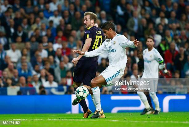 Harry Kane of Tottenham Hotspur shoots and Raphael Varane of Real Madrid deflects his shot into the net for Tottenham Hotspur first goal during the...