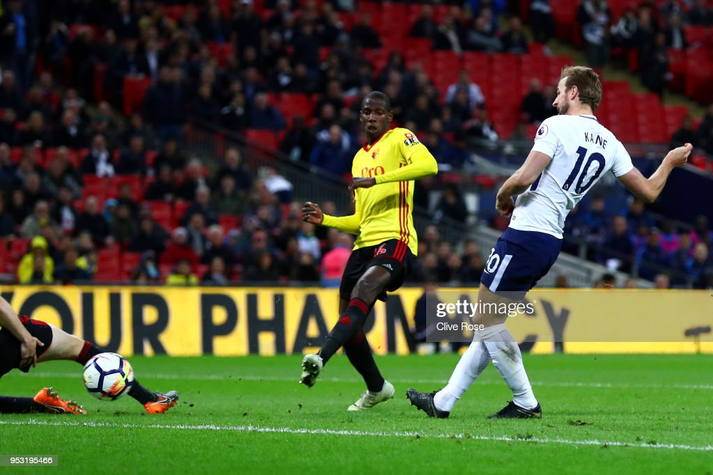 Harry Kane of Tottenham Hotspur shoots and scores his side's second goal during the Premier League match between Tottenham Hotspur and Watford at Wembley Stadium on April 30, 2018 in London, England.