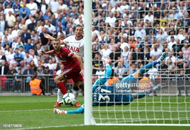 Eric Dier of Tottenham and Maxime Le Marchand of Fulham go up for a header during the Premier League match between Tottenham Hotspur and Fulham FC at...