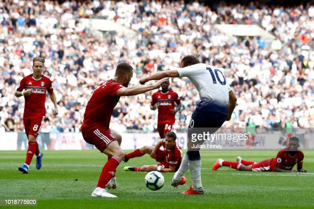 Harry Kane of Tottenham Hotspur shoots and scores his side's third goal during the Premier League match between Tottenham Hotspur and Fulham FC at...