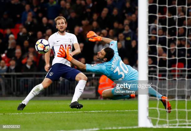 Harry Kane of Tottenham Hotspur shoots and scores past Orestis Karnezis of Watford a goal that is later disallowed during the Premier League match...