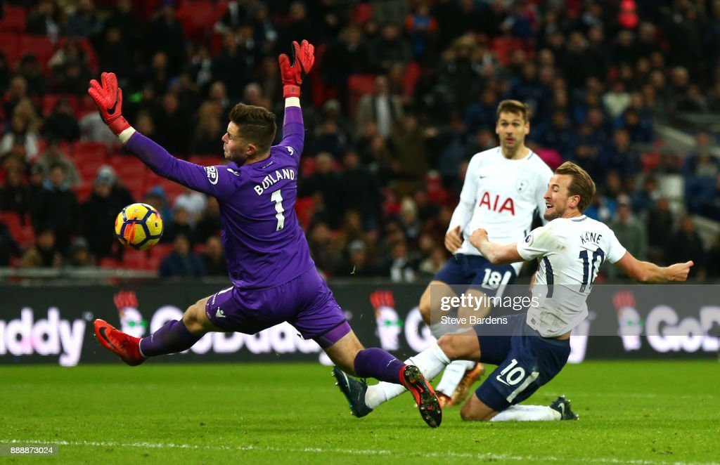 Harry Kane of Tottenham Hotspur shoots as Jack Butland of Stoke City attempts to save during the Premier League match between Tottenham Hotspur and Stoke City at Wembley Stadium on December 9, 2017 in London, England.