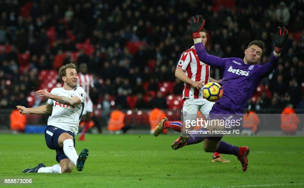Harry Kane of Tottenham Hotspur shoots as Jack Butland of Stoke City attempts to save during the Premier League match between Tottenham Hotspur and...