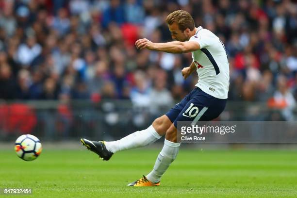 Harry Kane of Tottenham Hotspur shoots during the Premier League match between Tottenham Hotspur and Swansea City at Wembley Stadium on September 16...