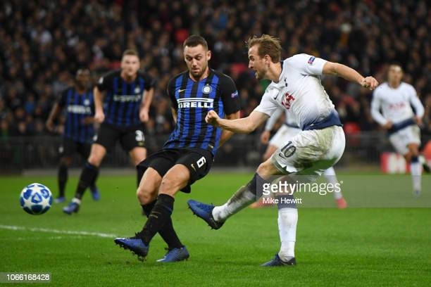 Harry Kane of Tottenham Hotspur shoots during the UEFA Champions League Group B match between Tottenham Hotspur and FC Internazionale at Wembley...