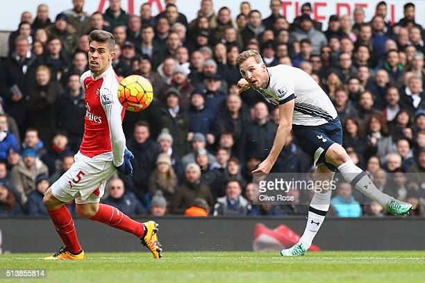 Harry Kane of Tottenham Hotspur shoots past Gabriel of Arsenal during the Barclays Premier League match between Tottenham Hotspur and Arsenal at...