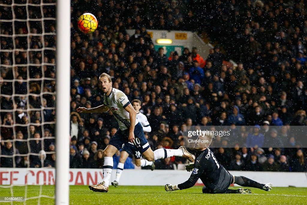 Harry Kane of Tottenham Hotspur shoots past Kasper Schmeichel of Leicester City hitting a cross bar during the Barclays Premier League match between Tottenham Hotspur and Leicester City at White Hart Lane on January 13, 2016 in London, England.