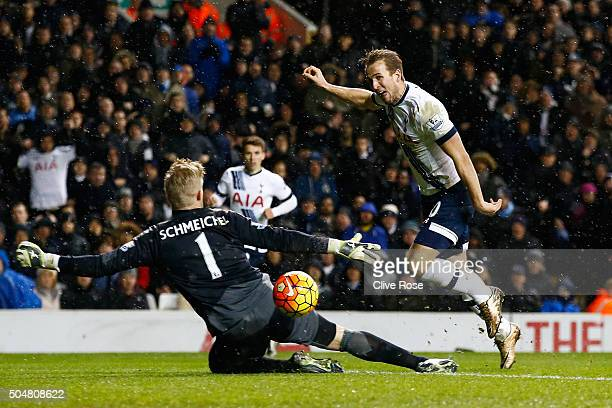 Harry Kane of Tottenham Hotspur shoots past Kasper Schmeichel of Leicester City during the Barclays Premier League match between Tottenham Hotspur...