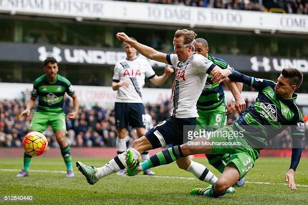 Harry Kane of Tottenham Hotspur shoots under pressure from Federico Fernandez of Swansea City during the Barclays Premier League match between...