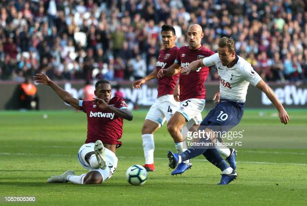 Harry Kane of Tottenham Hotspur shoots while under pressure from Issa Diop of West Ham United during the Premier League match between West Ham United...