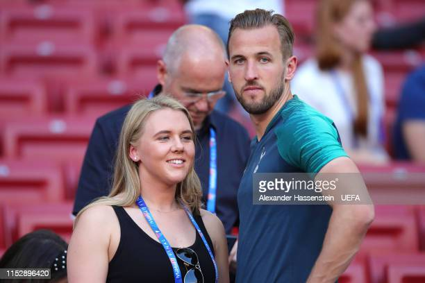 Harry Kane of Tottenham Hotspur speaks to his fiance Katie Goodland during the Tottenham Hotspur training session on the eve of the UEFA Champions...