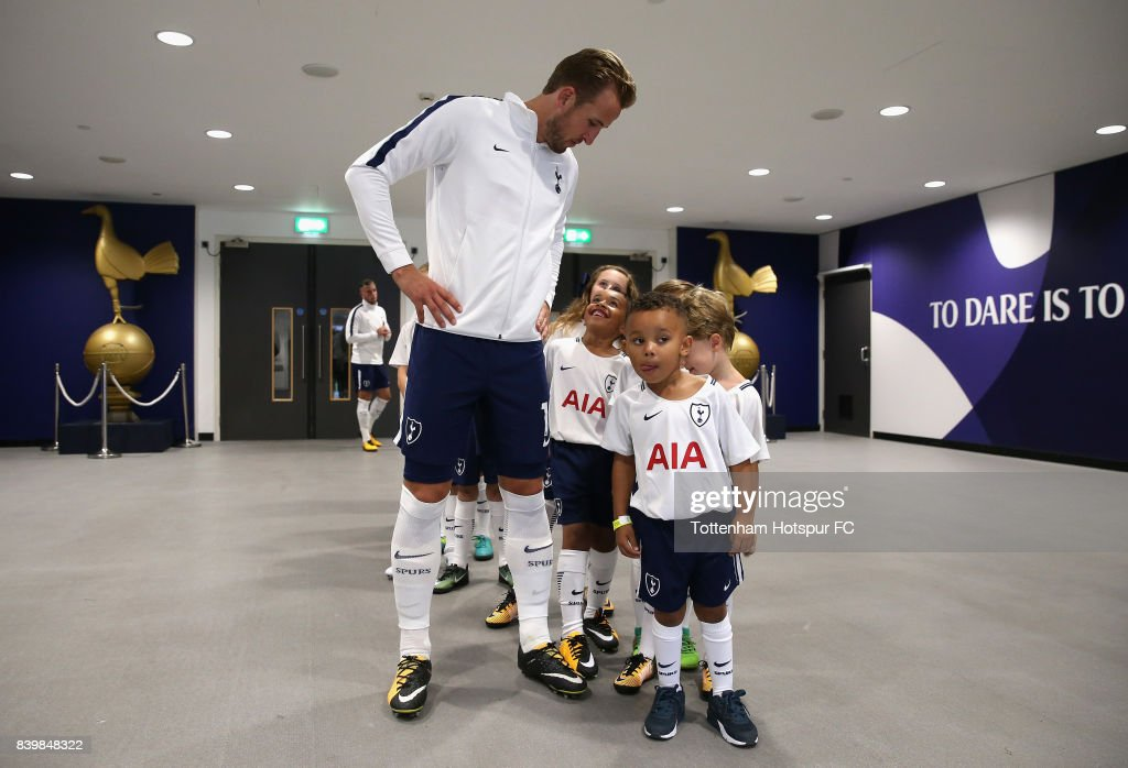 Harry Kane of Tottenham Hotspur speaks to the Tottenham Hotspur mascots in the tunnel prior to the Premier League match between Tottenham Hotspur and Burnley at Wembley Stadium on August 27, 2017 in London, England.