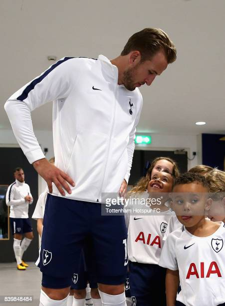 Harry Kane of Tottenham Hotspur speaks to the Tottenham Hotspur mascots in the tunnel prior to the Premier League match between Tottenham Hotspur and...