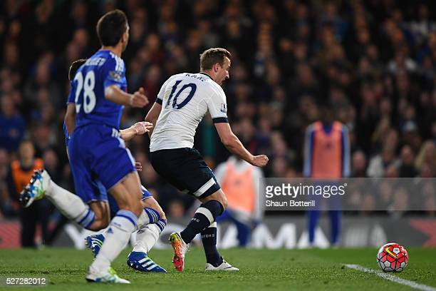 Harry Kane of Tottenham Hotspur splits open the Chelsea defence to score the opening goal during the Barclays Premier League match between Chelsea...