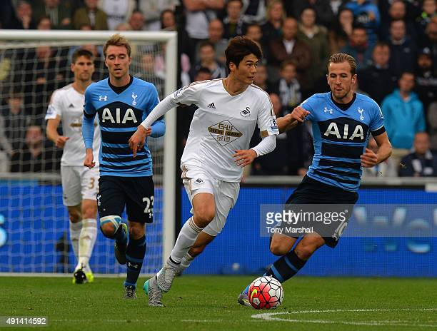 Harry Kane of Tottenham Hotspur tackles Ki Sung Yueng of Swansea City during the Barclays Premier League match between Swansea City and Tottenham...
