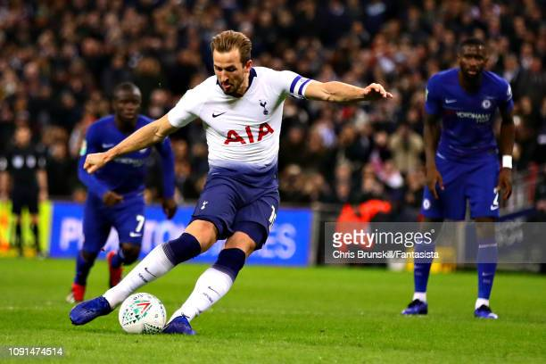 Harry Kane of Tottenham Hotspur takes a penalty to score his sides first goal during the Carabao Cup Semi Final First Leg between Tottenham Hotspur...