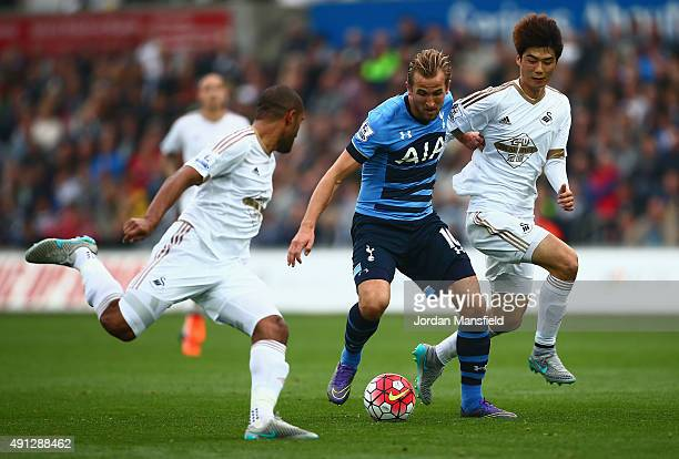 Harry Kane of Tottenham Hotspur takes on Ashley Williams of Swansea City and Ki Sung-Yeung of Swansea City during the Barclays Premier League match...