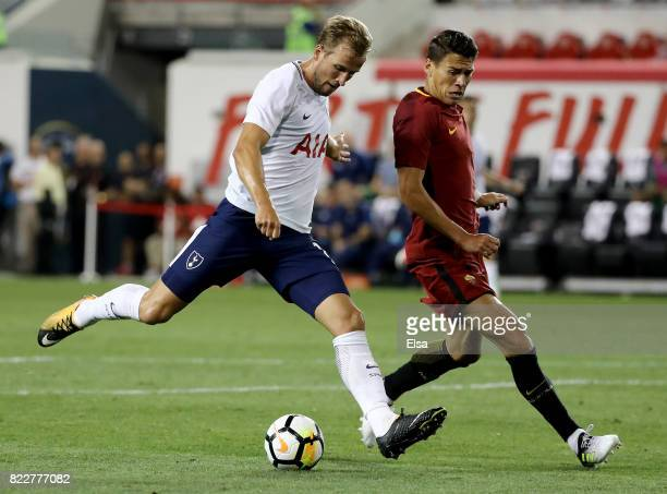 Harry Kane of Tottenham Hotspur takes the ball as Hector Moreno of Roma defends during the International Champions Cup on July 25 2017 at Red Bull...
