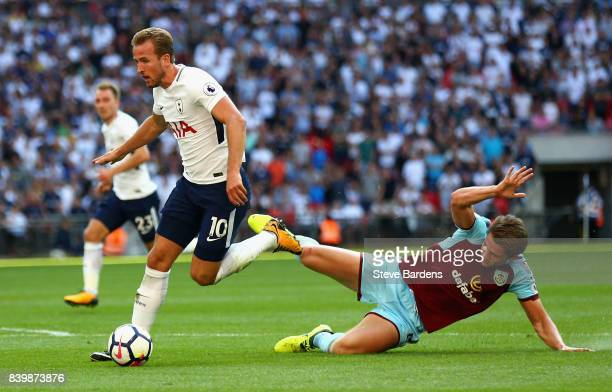 Harry Kane of Tottenham Hotspur takes the ball past James Tarkowski of Burnley during the Premier League match between Tottenham Hotspur and Burnley...