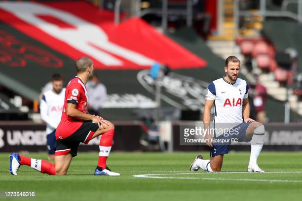 Harry Kane of Tottenham Hotspur takes the knee in support of the Black Lives Matter movement prior to the Premier League match between Southampton...