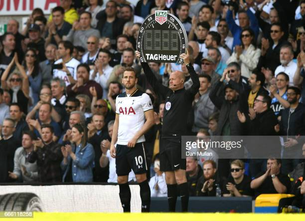 Harry Kane of Tottenham Hotspur waits to come on during the Premier League match between Tottenham Hotspur and Watford at White Hart Lane on April 8...