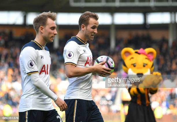 Harry Kane of Tottenham Hotspur walks off the pitch alongside Christian Eriksen after scoring a hattrick and winning the Premier League Golden Boot...