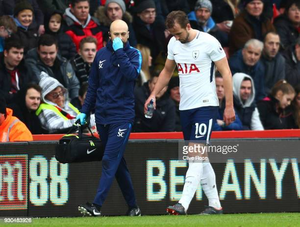 Harry Kane of Tottenham Hotspur walks to the bench with a member of the medical team during the Premier League match between AFC Bournemouth and...