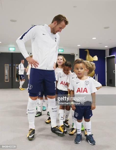 Harry Kane of Tottenham Hotspur with mascots prior to the Premier League match between Tottenham Hotspur and Burnley at Wembley Stadium on August 27...