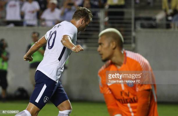 Harry Kane of Tottenham Hotspurs celebrates after scoring a penalty kick in the second half against Alphonse Areola of Paris SaintGermain during a...