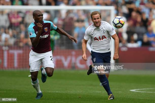 Harry Kane of Tottenham is chased by Angelo Ogbonna of West Ham during the Premier League match between West Ham United and Tottenham Hotspur at...
