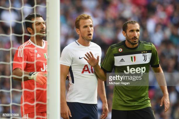 Harry Kane of Tottenham is marked by Gianluigi Buffon and Giorgio Chiellini of Juve during the preseason match between Tottenham Hotspur and Juventus...