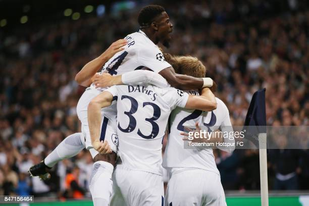 Harry Kane of Tottenham is surrounded by team mates after scoring their second goal during the UEFA Champions League group H match between Tottenham...