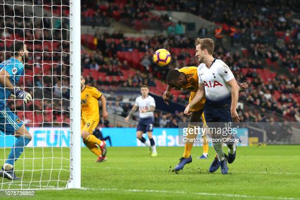 Harry Kane of Tottenham misses a chance as he seems to be pulled down by Willy Boly of Wolves during the Premier League match between Tottenham...