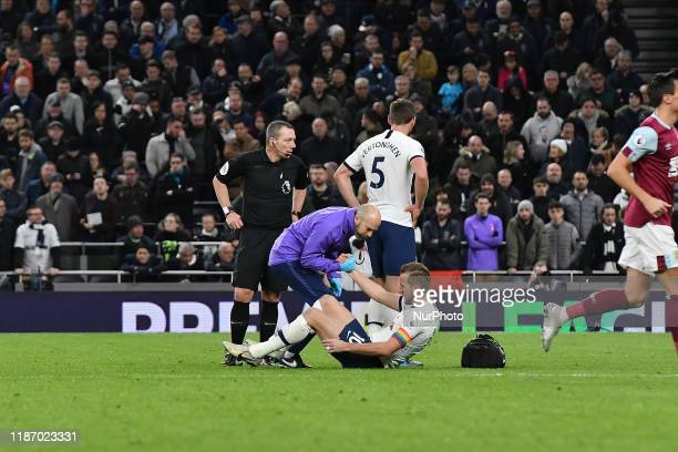 Harry Kane of Tottenham receives treatment during the Premier League match between Tottenham Hotspur and Burnley at White Hart Lane London on...