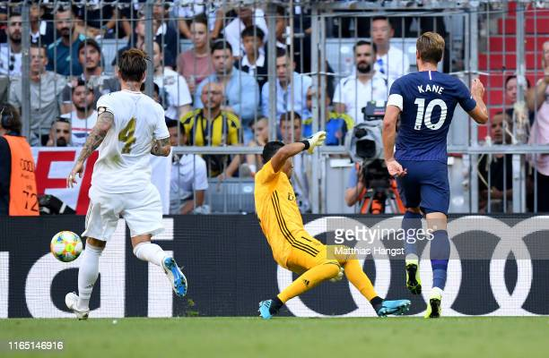 Harry Kane of Tottenham scores the opening goal during the Audi Cup 2019 semi final match between Real Madrid and Tottenham Hotspur at Allianz Arena...