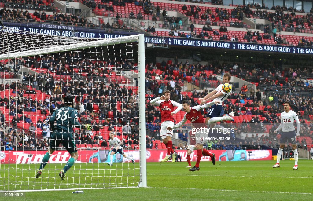 Harry Kane of Tottenham scores the opening goal during the Premier League match between Tottenham Hotspur and Arsenal at Wembley Stadium on February 10, 2018 in London, England.