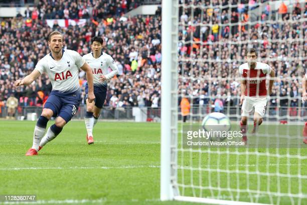 Harry Kane of Tottenham scores their equalising goal from the penalty spot during the Premier League match between Tottenham Hotspur and Arsenal FC...