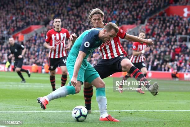 Harry Kane of Tottenham shoots past Jannik Vestergaard of Southampton to score the opening goal during the Premier League match between Southampton...