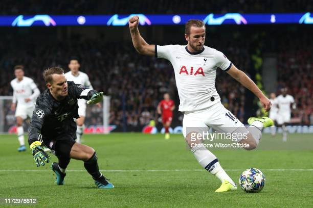 Harry Kane of Tottenham shoots round Bayern goalkeeper Manuel Neuer but misses during the UEFA Champions League group B match between Tottenham...