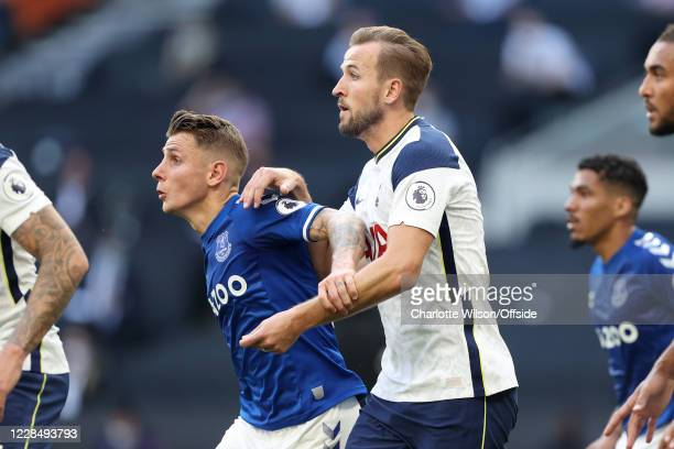 Harry Kane of Tottenham tussles with Lucas Digne of Everton during the Premier League match between Tottenham Hotspur and Everton at Tottenham...