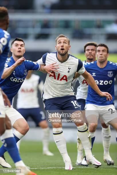 Harry Kane of Tottenham tussles with Michael Keane of Everton during the Premier League match between Tottenham Hotspur and Everton at Tottenham...