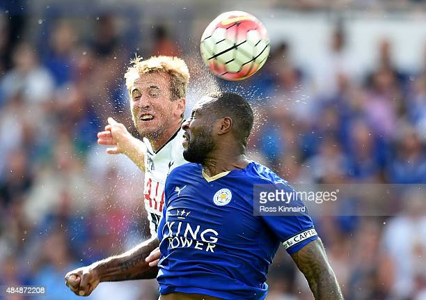 Harry Kane oif Tottenham is challenged by Wes Morgan of Leicester during the Barclays Premier League match between Leicester City and Tottenham...