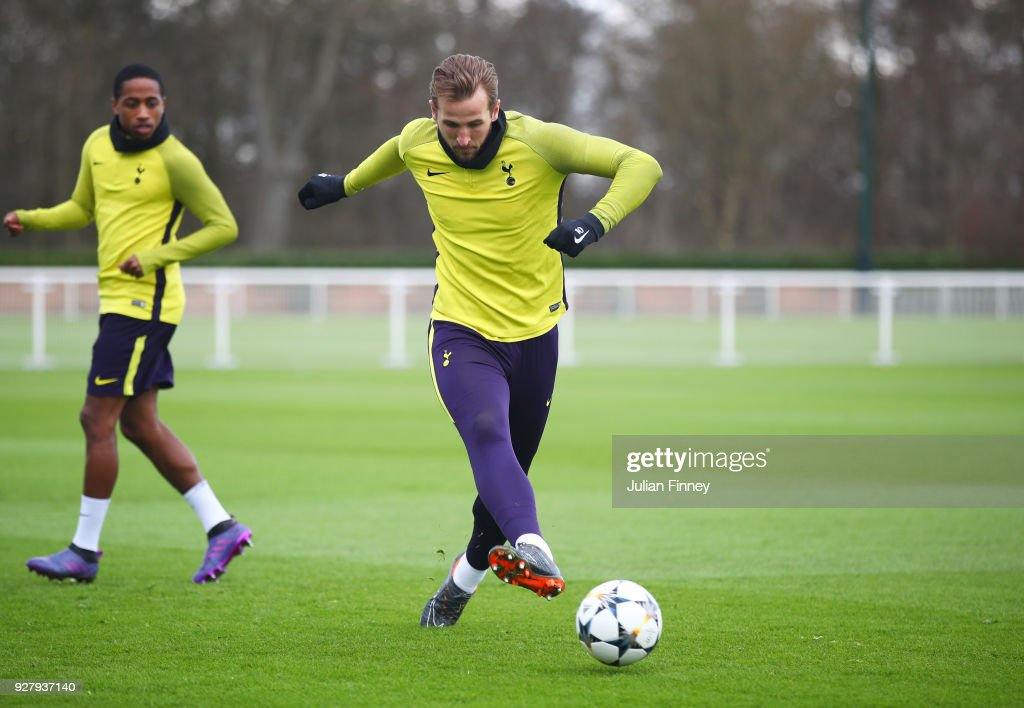 Harry Kane passes the ball during a Tottenham Hotspur training session on the eve of their UEFA Champions League match against Juventus at Tottenham Hotspur Training Centre on March 6, 2018 in Enfield, England.
